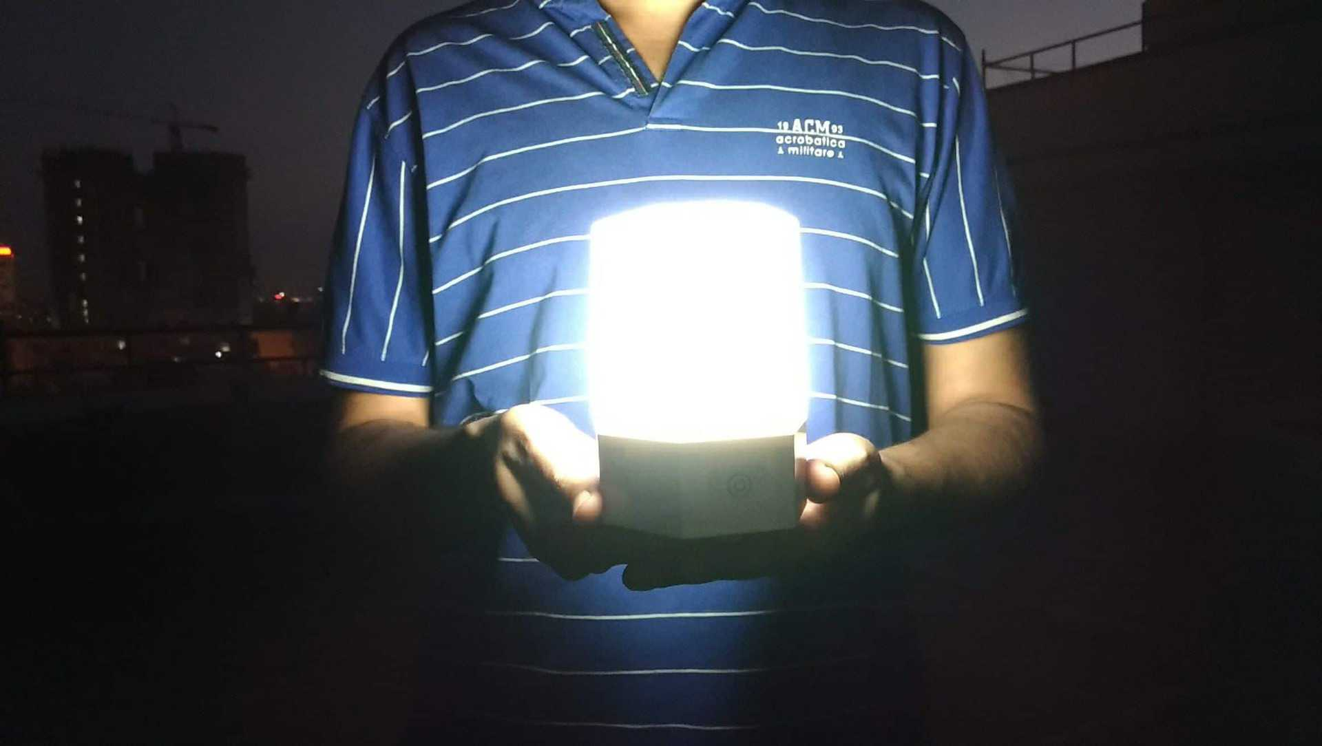 zuzilite-smart-lamp-review-moon-light-holding-on-hands